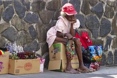 Dominica - local trade. Old woman selling handmade jewellery in Roseau, capital of Dominica stock image