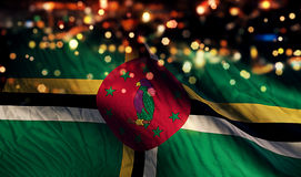 Dominica National Flag Light Night Bokeh abstrakt begreppbakgrund Arkivfoton