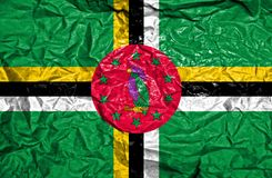 Dominica vintage flag on old crumpled paper background royalty free stock photos