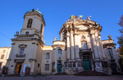 Dominican church, a priest and a beggar Stock Image