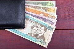 Dominican money in the black wallet Royalty Free Stock Images