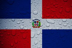 DOMINICAN REPUBLIC, CARIBBEAN, 23 September 2017 - Hurricane Maria leaves island under water. World weeps. Illustrative editorial image of flag and rain drops Royalty Free Stock Photography