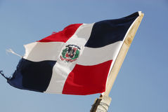 Dominican Republic flag. With the blue sky in the background royalty free stock image