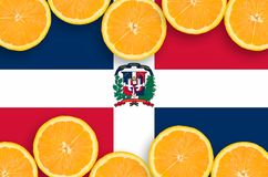 Dominican Republic flag in citrus fruit slices horizontal frame. Dominican Republic flag in horizontal frame of orange citrus fruit slices. Concept of growing as stock illustration