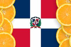 Dominican Republic flag in citrus fruit slices vertical frame. Dominican Republic flag in vertical frame of orange citrus fruit slices. Concept of growing as royalty free stock images