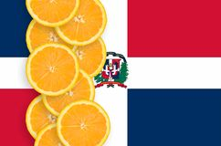 Dominican Republic flag and citrus fruit slices vertical row. Dominican Republic flag and vertical row of orange citrus fruit slices. Concept of growing as well vector illustration