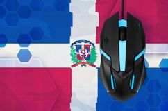 Dominican Republic flag and computer mouse. Concept of country representing e-sports team. Dominican Republic flag and modern backlit computer mouse. Concept of royalty free stock image