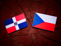 Dominican Republic flag with Czech flag on a tree stump  Royalty Free Stock Photography