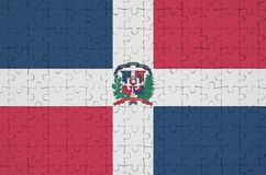 Dominican Republic flag is depicted on a folded puzzle stock photo