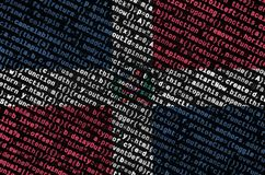 Dominican Republic flag is depicted on the screen with the program code. The concept of modern technology and site development.  stock photos