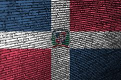 Dominican Republic flag is depicted on the screen with the program code. The concept of modern technology and site development.  royalty free stock photo