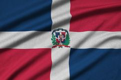 Dominican Republic flag is depicted on a sports cloth fabric with many folds. Sport team banner. Dominican Republic flag is depicted on a sports cloth fabric stock photos