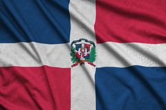 Dominican Republic flag is depicted on a sports cloth fabric with many folds. Sport team banner. Dominican Republic flag is depicted on a sports cloth fabric royalty free stock photography