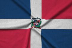 Dominican Republic flag is depicted on a sports cloth fabric with many folds. Sport team banner. Dominican Republic flag is depicted on a sports cloth fabric royalty free illustration