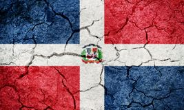 Dominican Republic flag. On dry earth ground texture background royalty free stock images