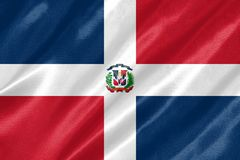 Dominican Republic Flag. With waving on satin texture royalty free stock photography
