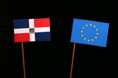 Dominican Republic flag with European Union EU flag isolated on black. Background Royalty Free Stock Images