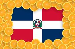 Dominican Republic flag in fresh citrus fruit slices frame. Dominican Republic flag in frame of orange citrus fruit slices. Concept of growing as well as import stock photography
