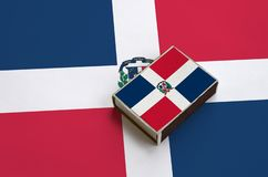 Dominican Republic flag is pictured on a matchbox that lies on a large flag.  stock photography