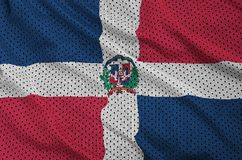 Dominican Republic flag printed on a polyester nylon sportswear. Mesh fabric with some folds stock photography