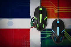 Dominican Republic flag and two mice with backlight. Online cooperative games. Cyber sport team. Dominican Republic flag and two modern computer mice with stock images