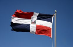 Dominican Republic flag. Waving against blue sky stock photo