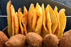 Dominican Republic food. Traditional plain snacks, fried on deep oil, for buying in streets in of Dominican Republic Stock Photo