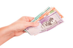 Dominican Republic money in female hand, close-up Stock Photography