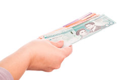 Dominican Republic money in female hand, closeup Royalty Free Stock Photos