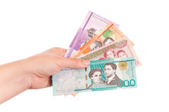 Dominican Republic money in female hand Stock Photos