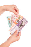 Dominican Republic money in female hands, close up Royalty Free Stock Photos