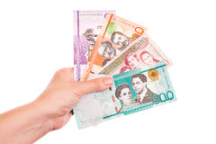 Dominican Republic money in female hands, closeup Royalty Free Stock Images