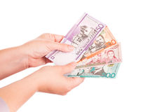 Dominican Republic money in hands, closeup photo Stock Photography