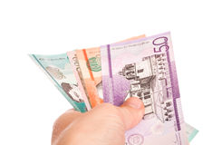 Dominican Republic money in a male hand, closeup Stock Photography