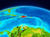 Dominican Republic from orbit. Satellite view of Dominican Republic highlighted in red on planet Earth. 3D illustration. Elements of this image furnished by NASA Royalty Free Stock Photos
