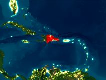 Dominican Republic in red at night. Satellite night view of Dominican Republic highlighted in red on planet Earth. 3D illustration. Elements of this image Royalty Free Stock Images