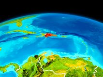 Dominican Republic in red. Satellite view of Dominican Republic highlighted in red on planet Earth with borderlines. 3D illustration. Elements of this image Royalty Free Stock Photos