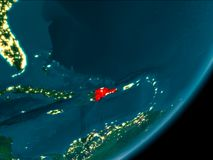 Dominican Republic from space at night. Night view of Dominican Republic highlighted in red on planet Earth with atmosphere. 3D illustration. Elements of this Stock Image