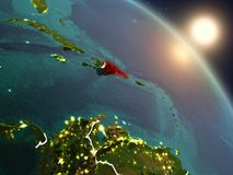 Dominican Republic from space during sunrise. Sunset above Dominican Republic from space on planet Earth with visible country borders. 3D illustration. Elements Royalty Free Stock Photography