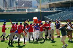 Dominican Republic Team. MINNEAPOLIS - AUGUST 14:  The Dominican Republic junior team  celebrates winning the championship of the Revival of Baseball in the Royalty Free Stock Image