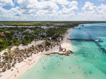 Dominican resort at Caribbean sea with white sand, sunshades and lighthouse royalty free stock photo