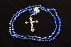Dominican rosary with Christian cross isolated on the black background Royalty Free Stock Photo