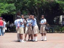 Dominican students. At the Columbus Park, in the colonial area, at the Santo Domingo de Guzman, capital of the Dominican Republic, Hispaniola island Stock Photo