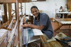 Dominican textile. Altos de Chavón,Dominican Republic, Hispaniola island: a man is making a cloth in a traditional machine. The Dominican Republic's most Stock Photo