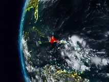 Dominikanska republiken från utrymme under natt Stock Illustrationer