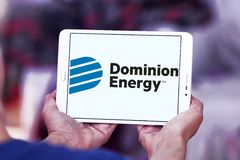 Dominion energy company logo. Logo of energy and home services company dominion energy on samsung tablet Royalty Free Stock Photography