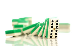 Domino. Suit of dominoes falling down royalty free stock photos