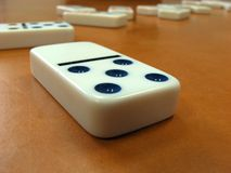 Domino. White domino with blue dots Royalty Free Stock Image