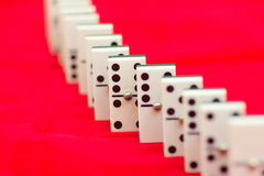 Domino. A row of domino tiles, waiting to fall Stock Photos