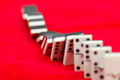 Domino. A row of domino tiles, falling Stock Photo